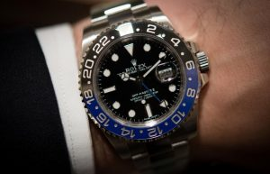 The black dials fake Rolex GMT-Master II 116710BLNR watches have dual time zone.