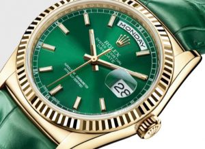 The gold fake watches have green leather straps.